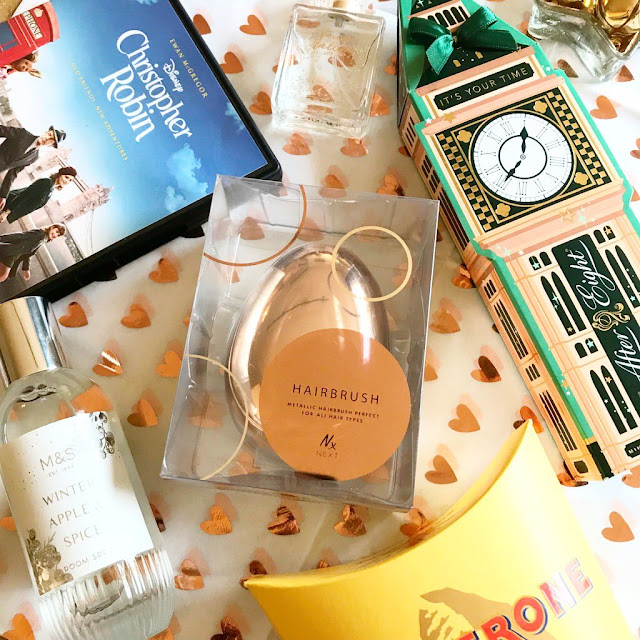 flatlay - Christopher Robin DVD, Rose Gold Tangle Teaser, M&S room spray, After Eight gift set
