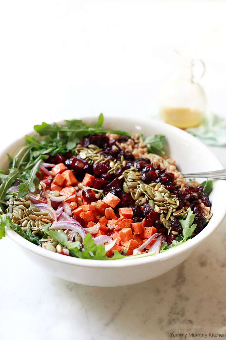 A beautiful autumn salad with farro, arugula, roasted vegetables, pepitas, and cranberries.