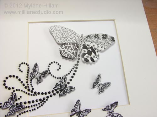 Detail of how to arrange the butterflies in the frame