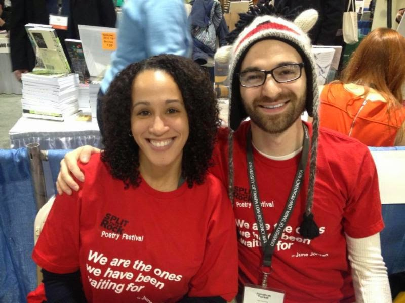 Photo of Jonathan Tucker and Katy Richey in 2012 Split This Rock festival t-shirts sitting at a table at AWP 2013