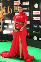 Apoorva in a Stunning Tight Leg Split Sleeveless Red Gown at IIFA Utsavam Awards 74.JPG