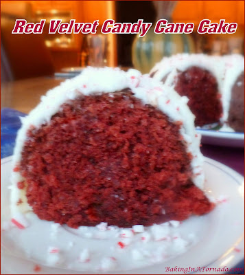 Beautiful for the holidays or any time of the year, Red Velvet Candy Cane Cake will be a new family favorite. | Recipe developed by www.BakingInATornado.com | #recipe #cake #Christmas