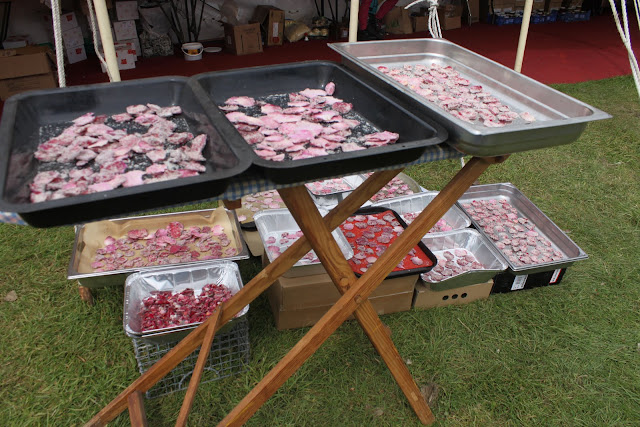 There is no end to the use of this ironing board. Drying rose petals in the sun.