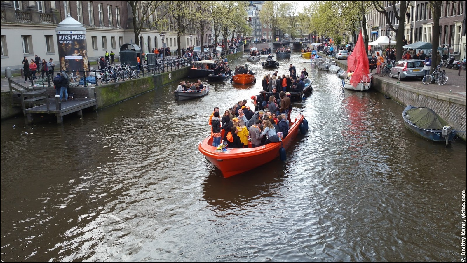 Orange boats in Amsterdam canals.