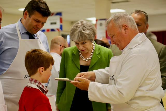 Theresa May tries cheddar at the British Cheese Awards at the Bath and West Show