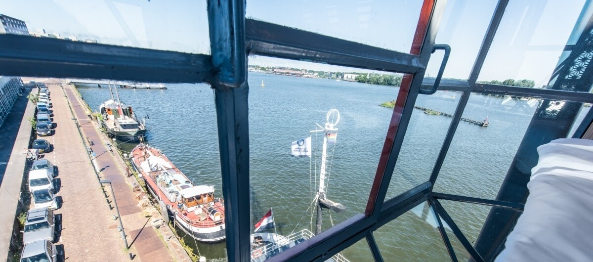 10-third-floor-bedroom-views-The-Yays-Architecture-with-the-Amsterdam-Crane-Apartment-www-designstack-co