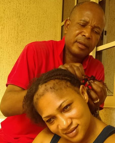 imo chief plaiting wife's hair