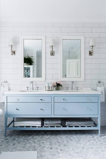 Bathroom with double sink and pale blue woodwork