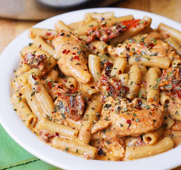 SUN DRIED TOMATO PASTA WITH CHICKEN AND CREAMY MOZZARELLA SAUCE