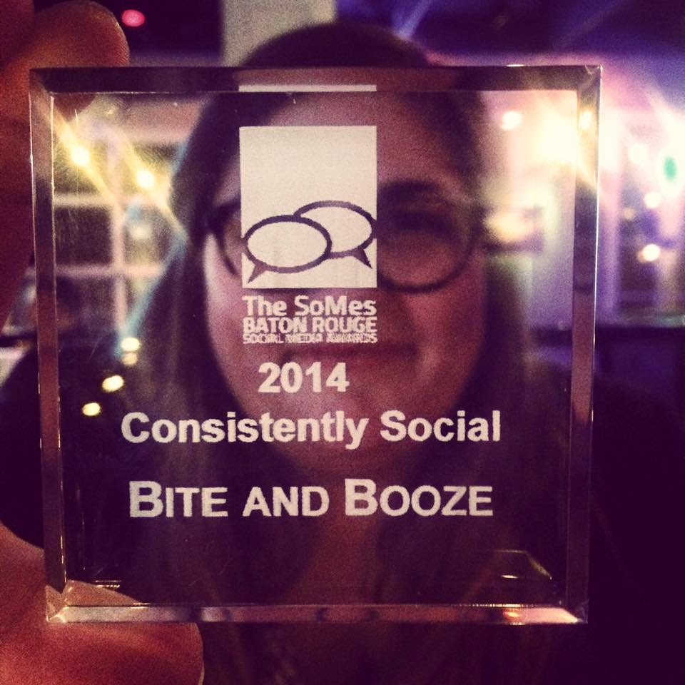 Blair holds up the Consistently Social award for Bite and Booze!