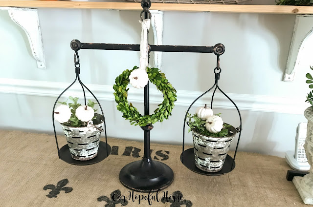 vintage scale olive buckets white pumpkins boxwood wreaths