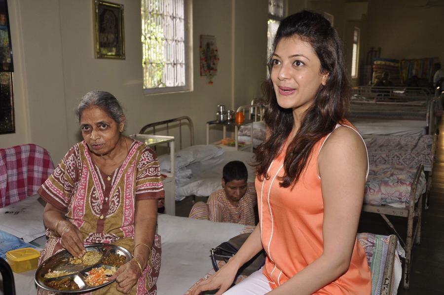 Kajal Agarwal Birthday Celebration Stills In Orange Top -9575