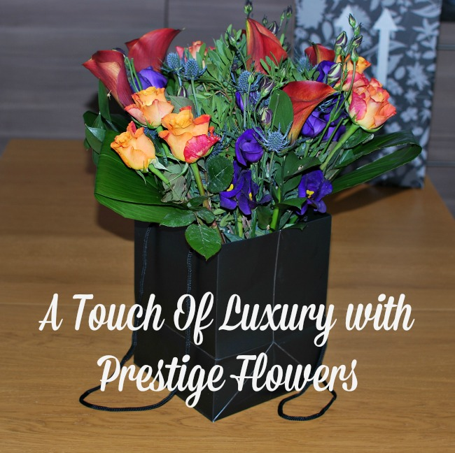 A-Touch-of-Luxury-with-Prestige-Flowers-text-over-image-of-flowers-in-black-bag