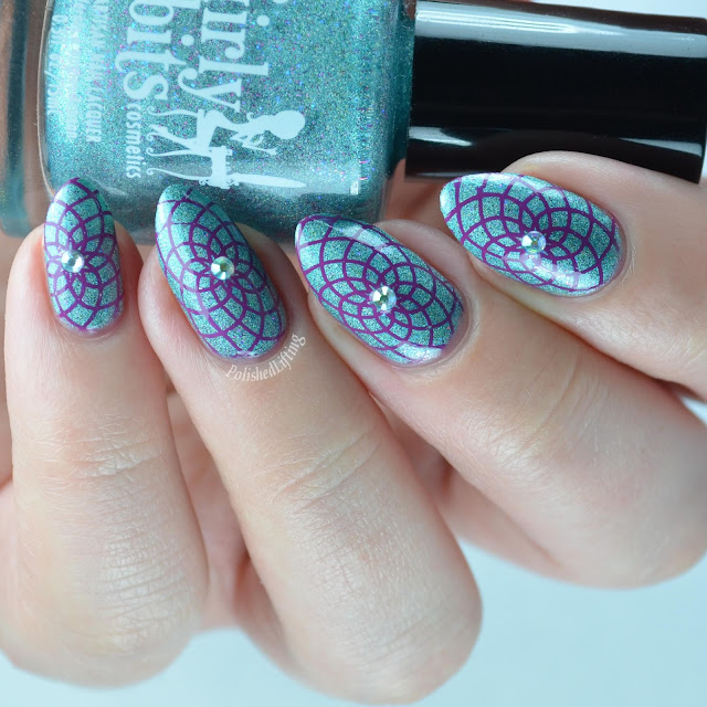 teal holographic nail polish with purple stamping
