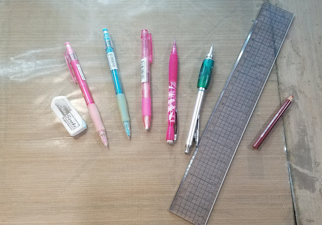 White Stroke eraser, Color Eno (Pink), Color Eno (Soft Blue), Mono Knock Eraser, Pentel Icy (HB lead), Pentel Graph Gear 1000 (B lead) Clear, gridded acrylic ruler, Prismacolor Color Pencil