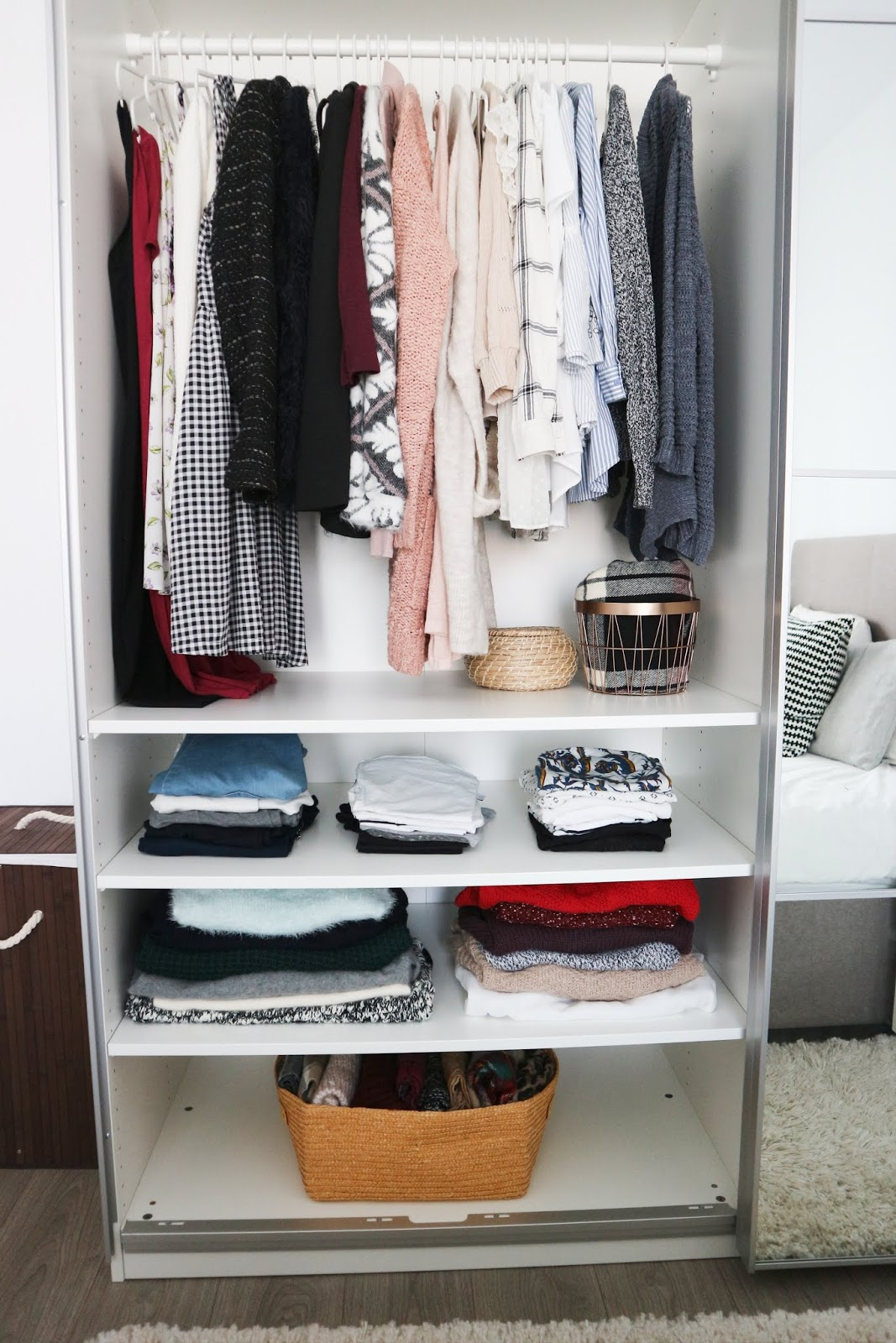 minimalist wardrobe with hangers and shelves