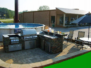 charming backyard design with bricks outdoor kitchen near on ground round pool near beige armchairs and grey parasol