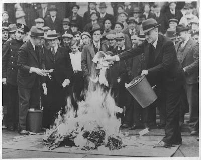 "Crowds gather as hundreds of thousands of dollars in ""Scrip Money"" are burned. The notes were issued after the bank had closed. April, 1933. Local Identifier: 306-NT-177.567C Source: http://unwritten-record.blogs.archives.gov/2014/10/29/black-tuesday-85-years-gone-by/"