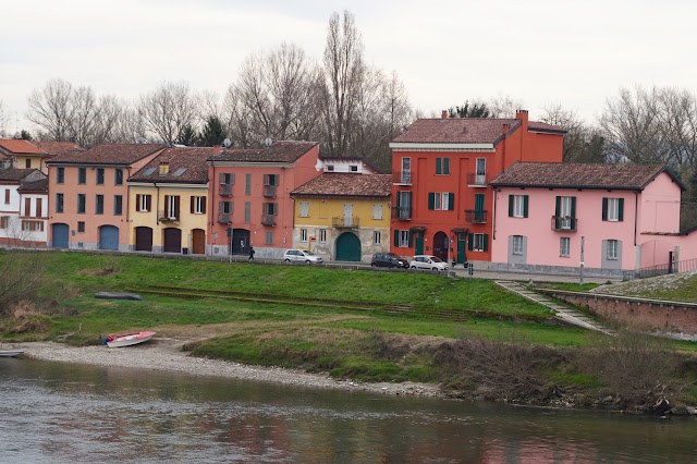 Painted houses on the river bank
