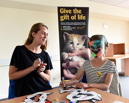 Making cat masks at Mitcham Homing Centre