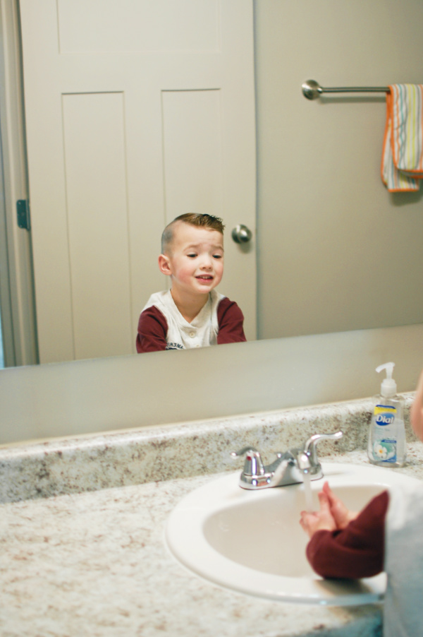 Little boy smiles after potty training success