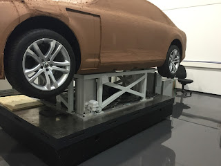 car model mounted on higher posts