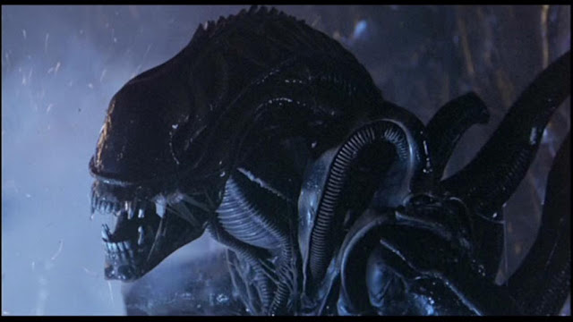 A Xenomorph from Aliens ready to attack
