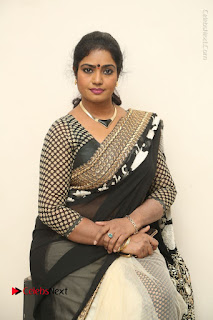 Telugu Actress Jayavani Jayavani Stills in Black Saree at Intlo Deyyam Nakem Bhayam Success Meet  0050.JPG