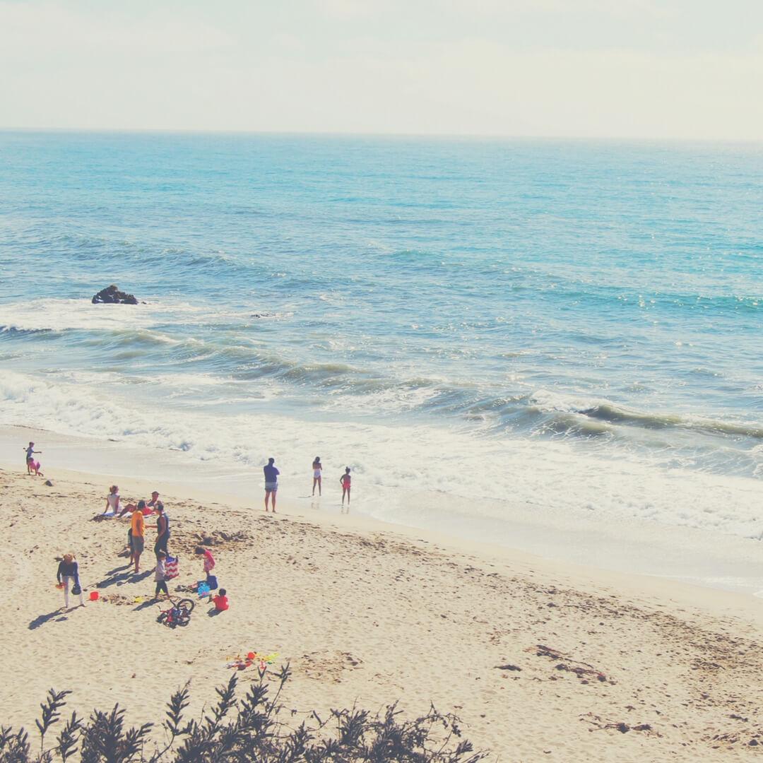 A family enjoys the beach in summer