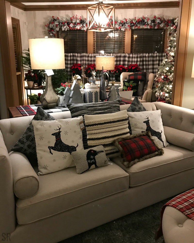 a couch with Christmas pillows on it