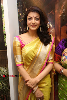 Actress Kajal Agarwal Stills in Golden Silk Saree at Trisha Sesigner Store Launch  0070.jpg