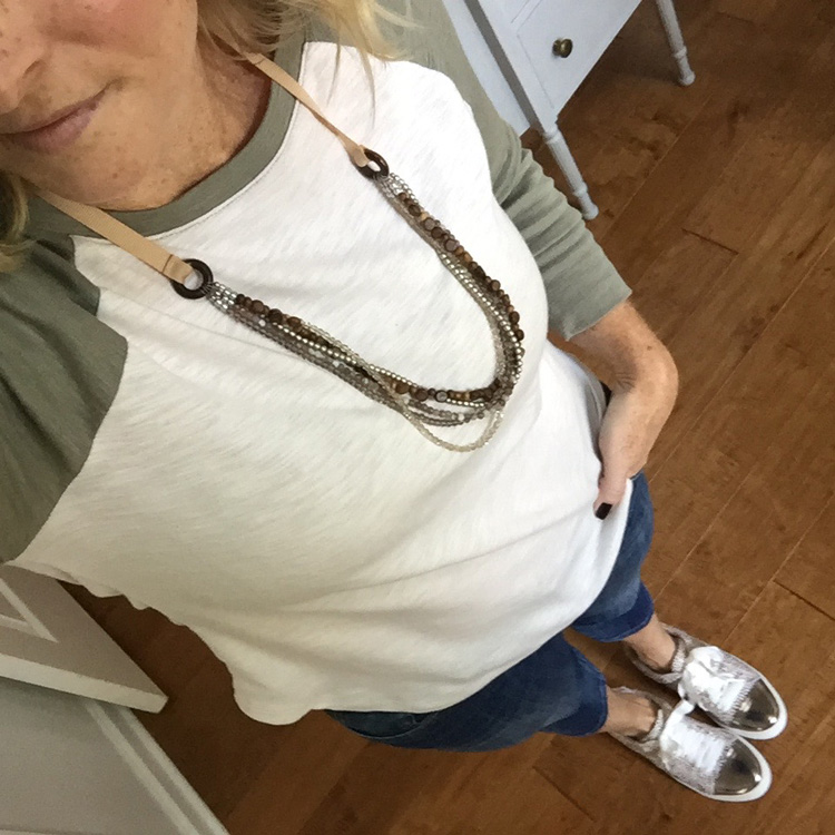 baseball tee shirt with multistrand necklace and leopard print shoes