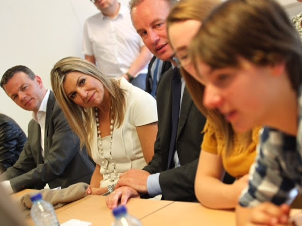 Queen Maxima  visits the Summa College in Eindhoven. Queen Maxima wars Gucci dress