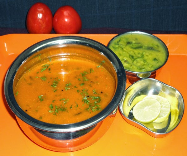tomato curry in a serving bowl