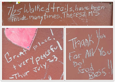 Collage of chalk drawings and messages at Graeme Park - includes a heart and messages thanking staff and saying how nice the site is