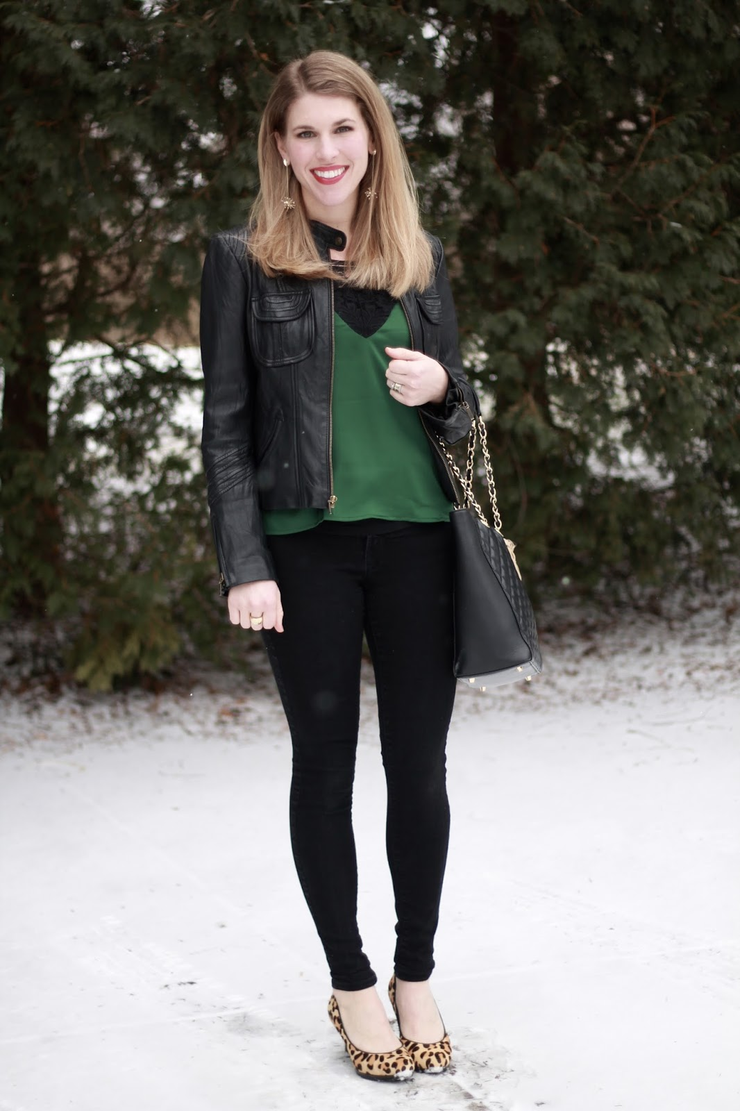 green and black lace cami, black jeans, black moto jacket, leopard heels