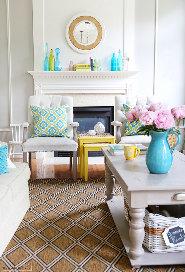 family room with summer colurful decor