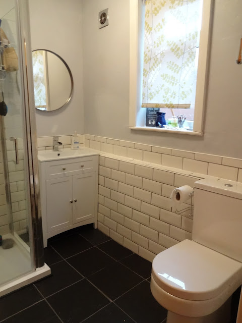 White Metro Tiles in Bathroom with Black Flooring