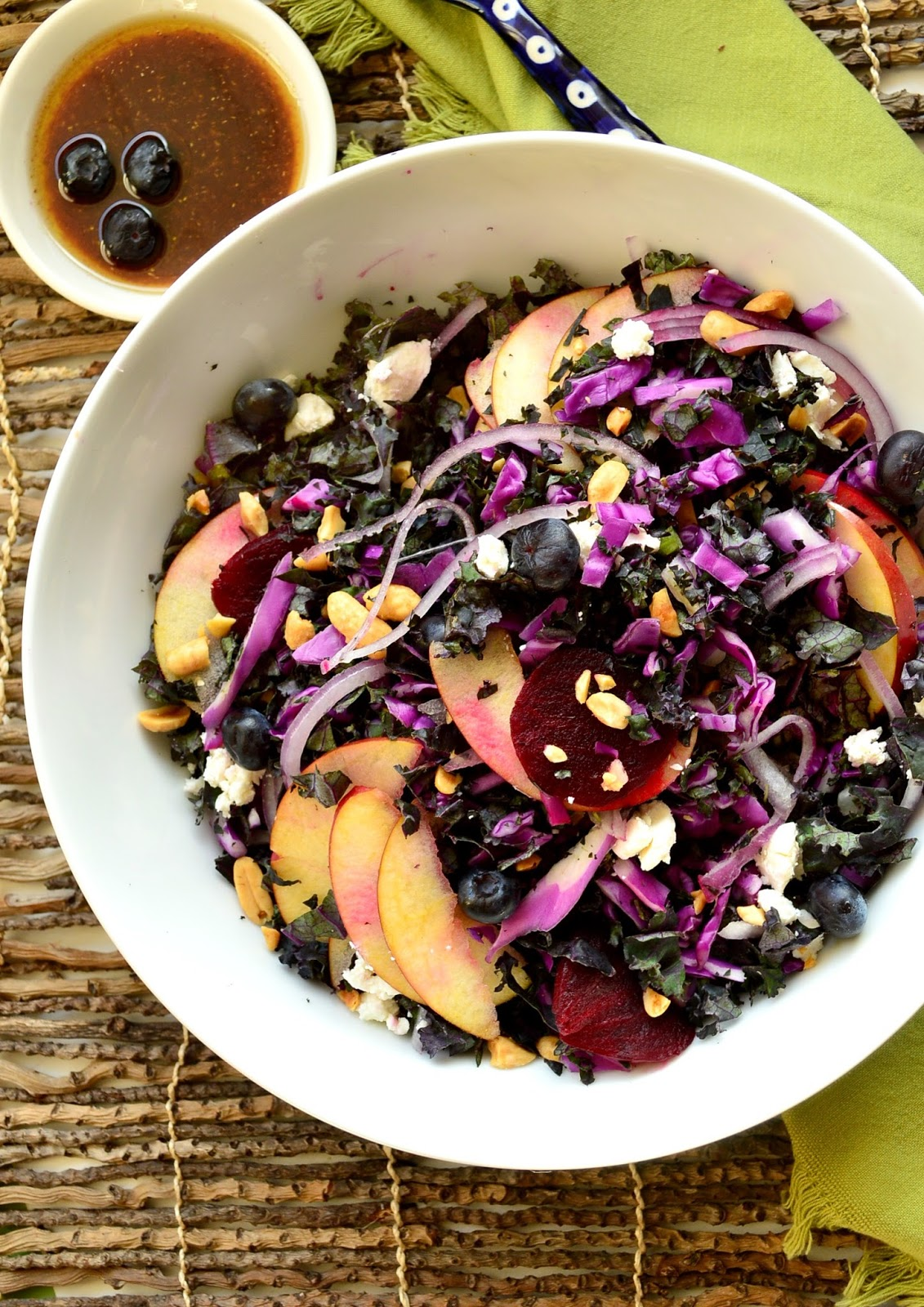 This purple kale salad with blueberries, apples, beets, peanuts and goat's cheese also has the most wonderful blueberry vinaigrette. Add some color to you life with this awesome salad! www.thisishowicook.com #salad #kale #blueberries