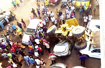 Accident In Lagos As Truck Falls Off Berger Bridge, Lands On Two Cars