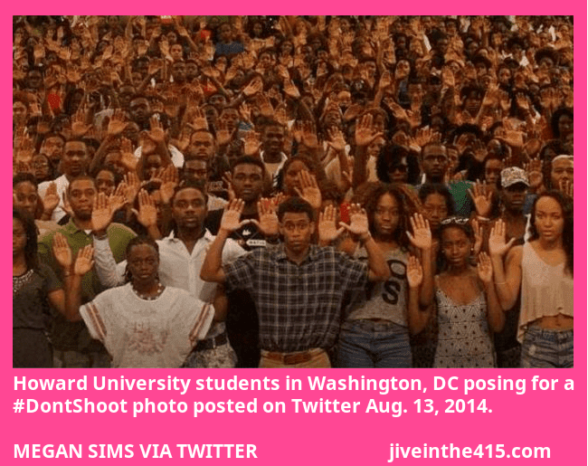 Hundreds of Howard University students in Washington, DC pose for the camera with their arms up in surrender, for the hashtag don't shoot campaign.