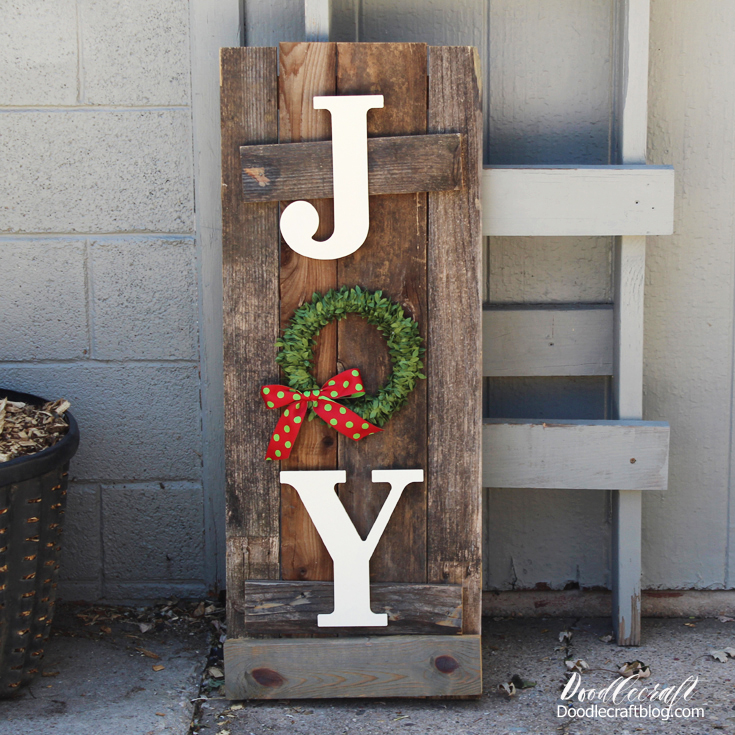 Make Christmas front porch decor with old reclaimed fence boards with the word JOY in a vertical design on the front, tall and skinny for standing near the front door.