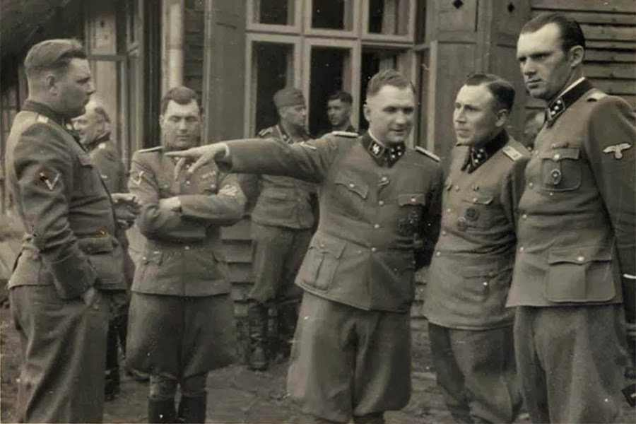 A group photo of the mass murderers of Auschwitz: Josef Kramer, Josef Mengele, Richard Baer, Karl Höcker (from left; man at right unidentified).