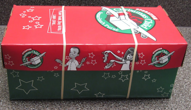 A full Operation Christmas Child shoebox for a 10 to 14 year old boy, banded and ready to go.