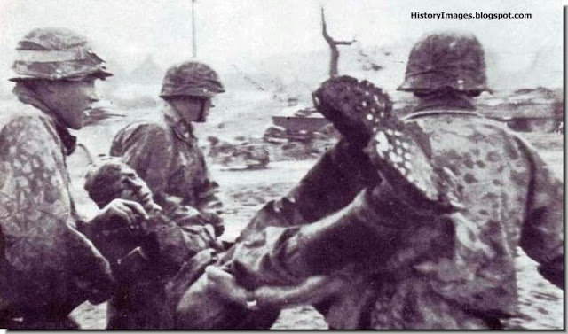 "carry their wounded comrade 5th Panzer Grenadier Division  SS ""Viking"""