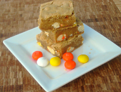 blondies on a white plate with M&ms next to them