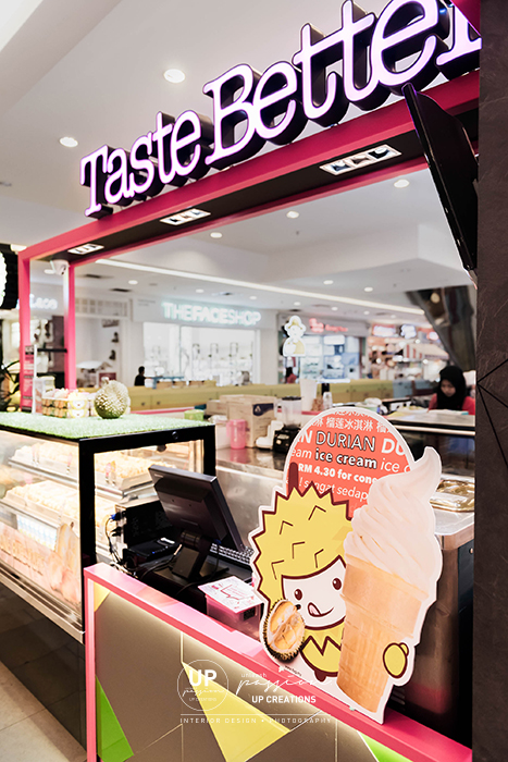 taste better empire subang kiosk with striking corporate pink color metal structure with lighted main signage