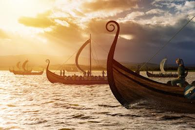 Barcos vikingos navegando en busca de nuevas tierras