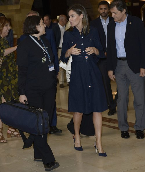 Queen Letizia wore Hugo Boss Caddli Stretch-Denim Dress and she wore Carolina Herrera High heel slingback pumps, and carried camel culutch