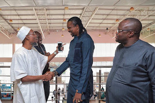 When a true Arsenal fan meets legendary Arsenal player: Governor Aregbesola all smiles as he meets Kanu Nwankwo